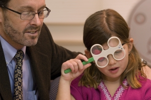 doctor doing vision therapy with a child